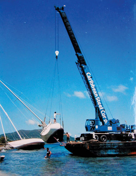 Fatty bought Wild Card on the beach after Hurricane Hugo in 1989. Here it is being lifted back into the water.